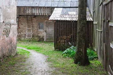 rustic courtyard with barn and wood
