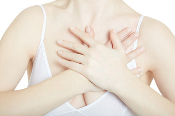 Young woman with chest pain close up on torso isolated on white, clipping path