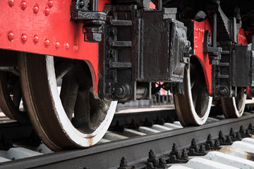 The wheels of locomotives on the railroad. Closeup.