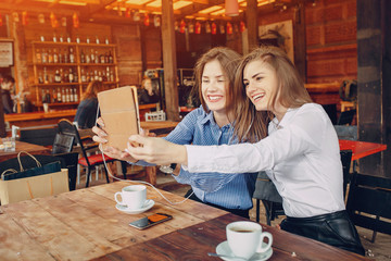 two girls in a cafe