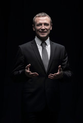 Portrait of an elegant handsome business man isolated on black b