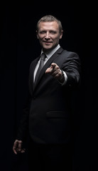 Confident businessman pointing with the index finger forward. Is