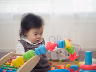 cute  baby girl play toy at home