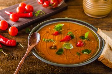 Delish tomato soup with bread and chilli