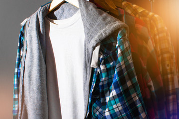 Hipster plaid shirts hang on on the Store Rack in a clothing store, fashion shop designer, mall shopping, wardrobe