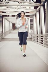 Woman running on bridge