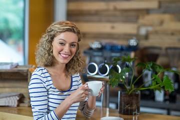 Portrait of woman having coffee in café