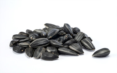 Heap of sunflower seeds isolated on the white background.