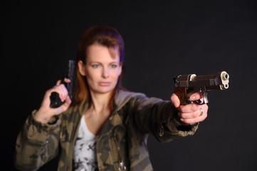 Woman with gun in uniform