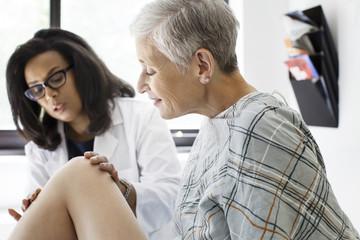 Doctor examining patient,
