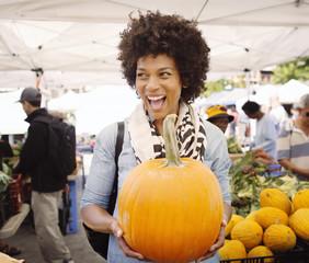 Mature woman buying pumpkin