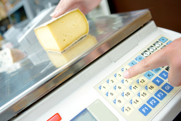 Weighing cheese on electronic scales