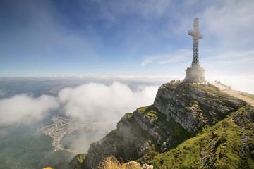 Iron cross on mountain top