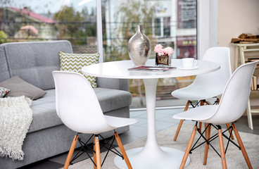 White round table in modern interior of living room