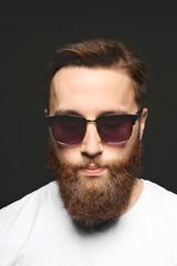 Portrait of handsome bearded man on black background