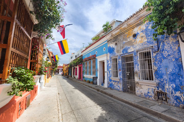 CARTAGENA, COLOMBIA - MAY 23: Flags blow in the breeze on a colorfully painted street in Cartagena, Colombia on May 23, 2016.