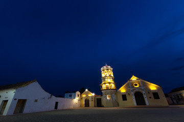 The Santa Barbara Church during the blue hour  in Mompox, Colombia.