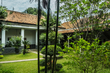 Beautiful green landscape of an old house building photo taken in Pekalongan Indonesia