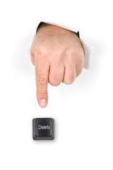 Finger pushing delete key.