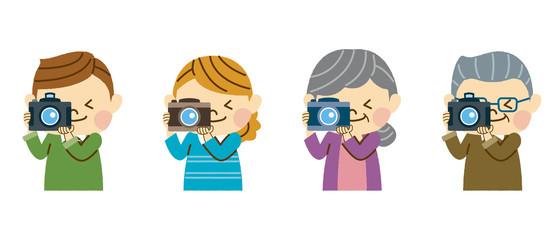 デジカメで写真を撮る家族