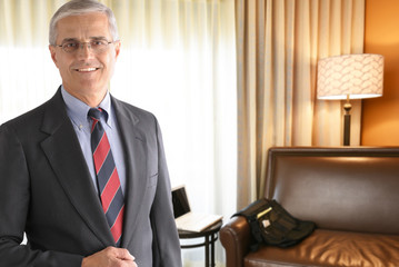 Mature Businessman in Hotel Room