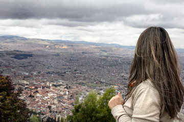 Visitor Looking Out on Bogota, Colombia