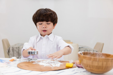 Asian Chinese little boy prepare for baking cookies