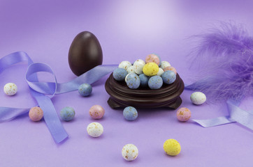 Lilac / mauve  Easter egg background with many speckled eggs