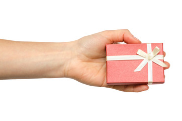 hand of young girl holding gift box.