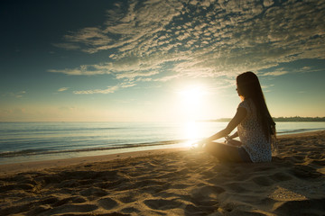 woman relaxes and enjoys the sunset