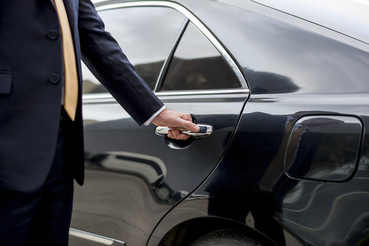 Businessman Handle Limousine Door Car