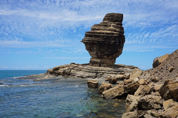 Rock formation on the sea shore, the Bonhomme of Bourail, New Caledonia, Grande Terre island, south Pacific