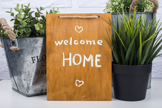 Wooden board with text welcome home