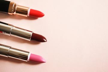 Lipsticks on a beige background