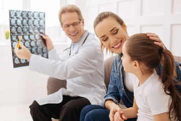 Charming young family happy hearing good news