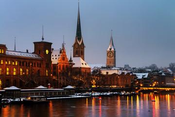 Zurich, Switzerland. Illuminated St. Peter Church and old Clock tower