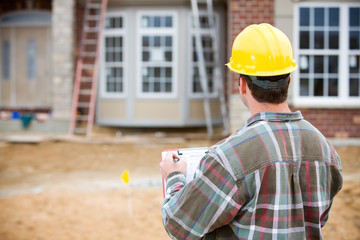 Construction: Home Inspector Doing Review