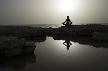 Evening meditation on seaside