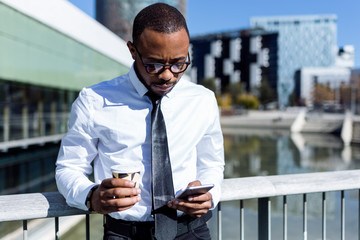Handsome elegant man with coffee and phone
