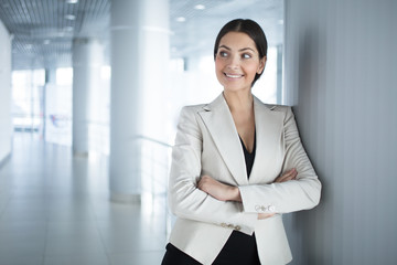 Surprised Business Woman With Arms Crossed in Hall