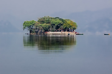 Tal Barahi Temple island in hazy Lake Phewa with reflections, Pokhara, Nepal