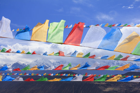 Row of prayer flags and Meili snow mountain, Deqing, Yunnan, China