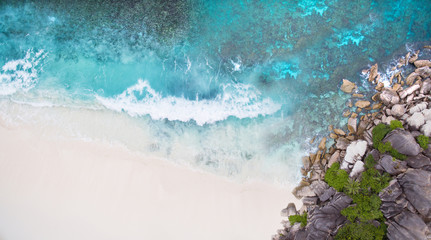 Seychelles Island white tropical paradise beach, turquoise sea and granite rocks aerial landscape. La Digue Grand Anse beach seascape.