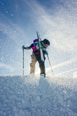 Young girl with skis and snowboard