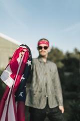 Man giving us flag