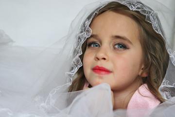 Little girl with a veil