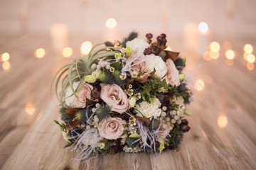 Close-up of bridal bouquet on floor