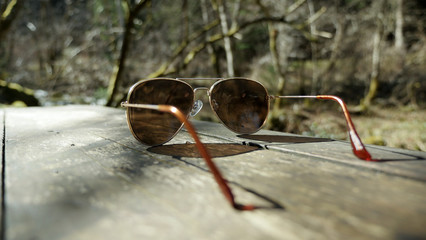Sunglasses isolated on table in nature
