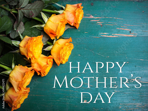 Mother's day card with bouquet of orange roses on a wooden background