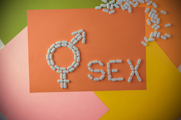 The word sex with capsules and pills with treatments for erectile dysfunction.